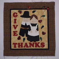 Pilgrim couple and words Give Thanks