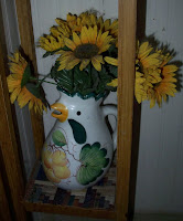Chicken vase with sunflowers