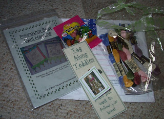 opened package of pattern, jelly beans, bookmark, card and ribbon