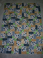 Disappearing Nine Patch quilt using kitty fabrics in shades of browns and grays