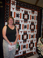 My blogger friend, Pam in front of the Texas Longhorn Quilt she made for her son