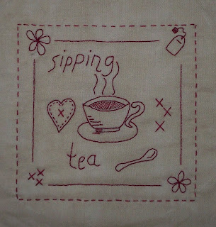 stitchery of Bea's Block of the month for August, a teacup, teabag, heart and flowers
