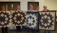 Holding our broken star quilts in Shipshewana