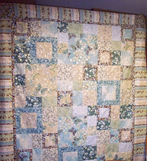 Quilt top for shop made with squares and rectangles