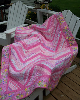 pink string quilt on chair outside