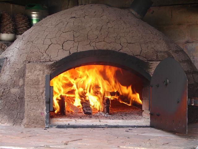 Tu horno de barro hornos de barro argentina buenos - Cocinar en horno de lena ...