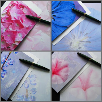 Flower blank greeting card set of four in shades of pink, blue, and lavender.