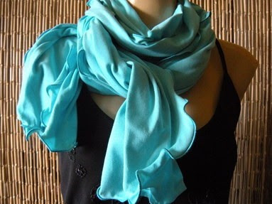 A turquoise neck scarf for summer.