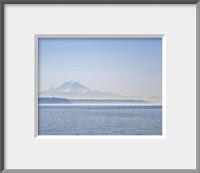 a framed photograph of a misty foggy day at Mount Rainier and Elliott Bay in Seattle