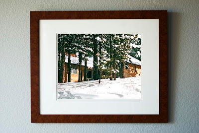 A framed photo of a textured artistic interpretation of my off-grid home on a snowy winter day.