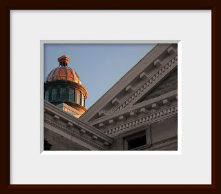Copper dome on classical Doric architecture building.