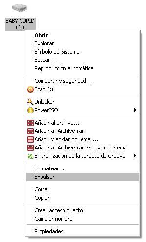 Cómo guardar archivos de fotos de mi laptop a memoria USB?