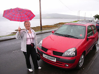 CraftyWhippet singing in the rain with her far-travelled wee car