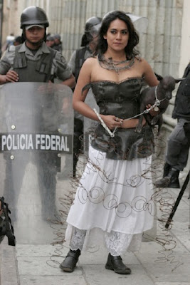 [Artist Gabriela León is photographed on the riot-torn streets of Oaxaca in the