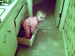 Taylor playing in the bathroom drawer