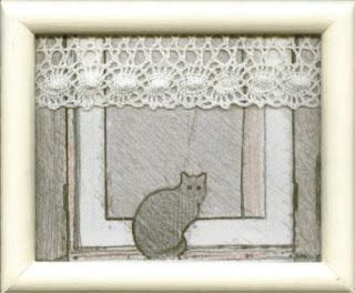 kotek w oknie