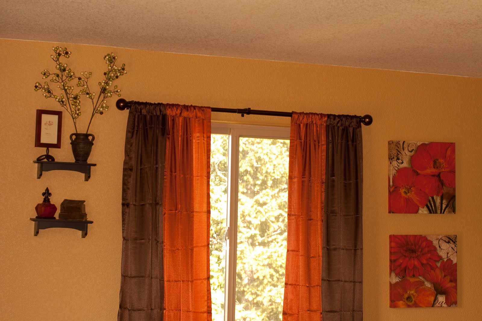 Organized chaos master bedroom facelift - Orange and brown curtains ...