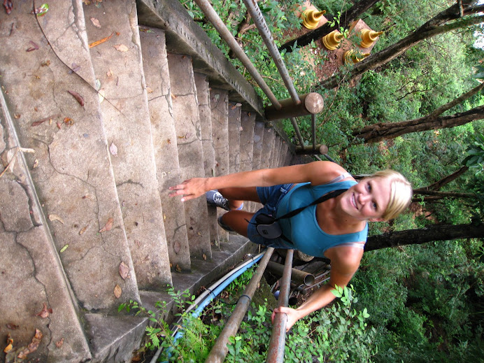 Climbing stairs to get to a temple at the top of a mountain.
