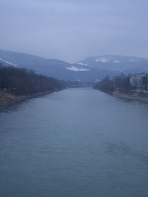 best travel photos salzach river in salzburg austria in winter mountain background