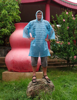 The latest fashion in plastic raincoats, only 20 Baht.