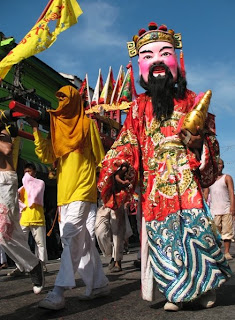 Vegetarian festival - carrying statues of the gods