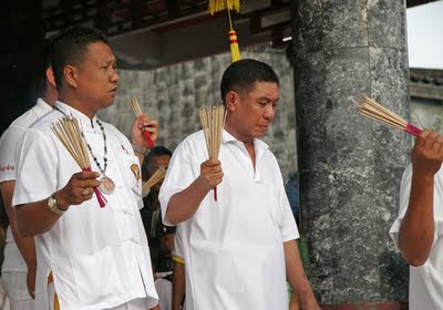 Men with incense at Kathu Shrine