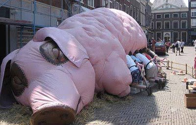 Giant Pig Feeding Humans
