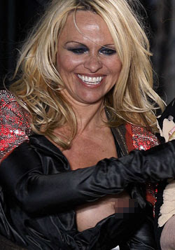 Pamela Anderson Pops Out on Paris Runway