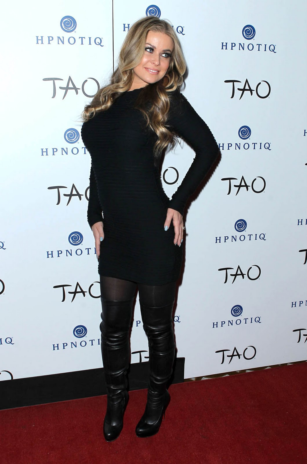 Carmen Electra flashes lingerie beneath ultra-sheer LBD in