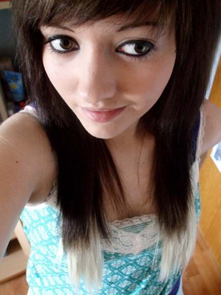 Emo hairstyles for girls can be long with choppy layers and side swept bangs