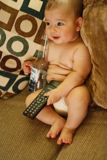 Cute baby boy drinking and watching tv model photo