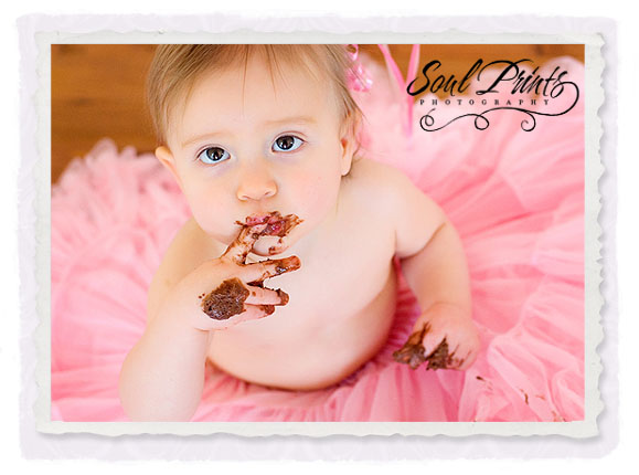 Cute baby birthday photos while eating choclate