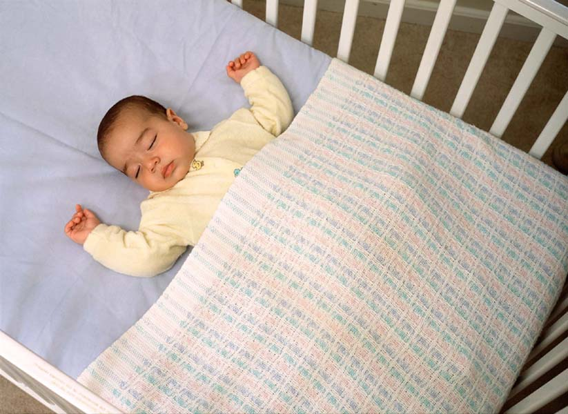 Cute baby sleeping on bed desktop wallpaper
