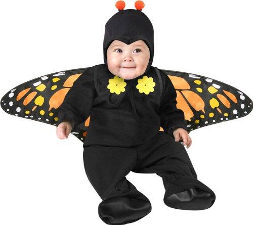 Cute baby boy in black butterfly costume