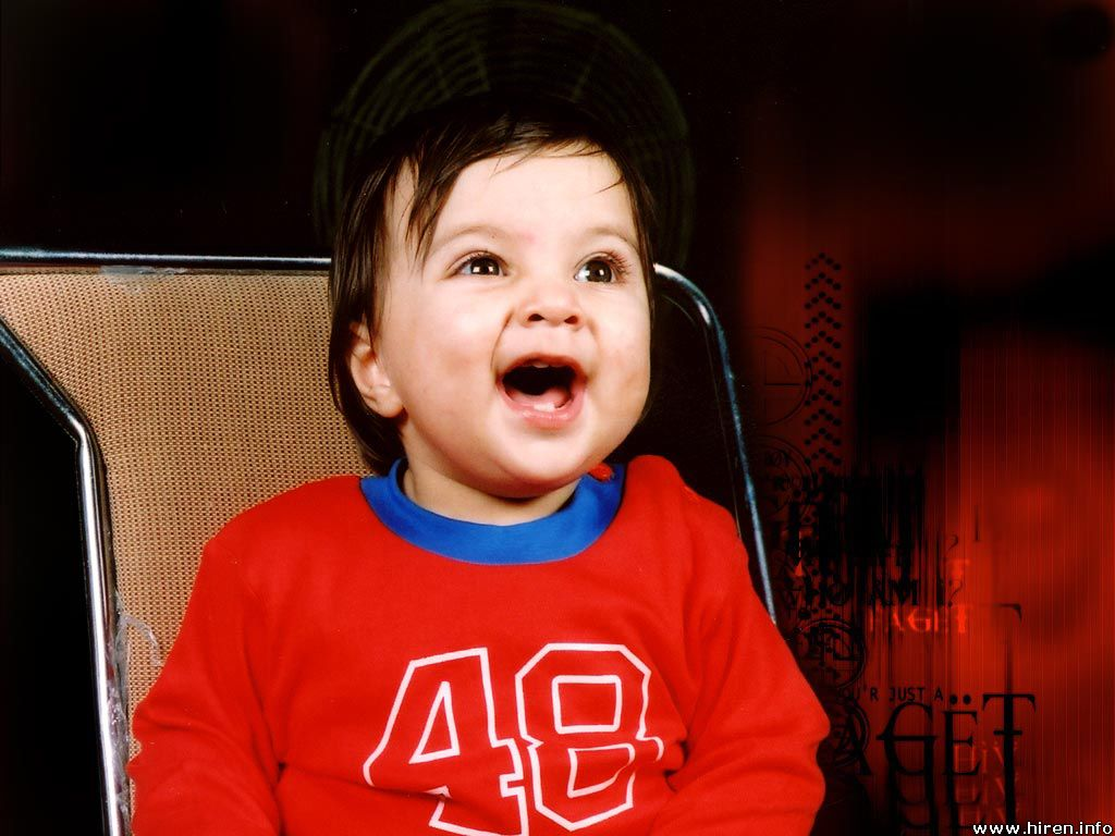 laughing baby in red dress photo