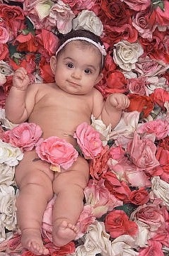 Cute Baby girl in flowers