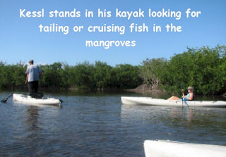 Photo of Mango Creek Lodge guide Kessel and a guest kayaking in a mangrove canal