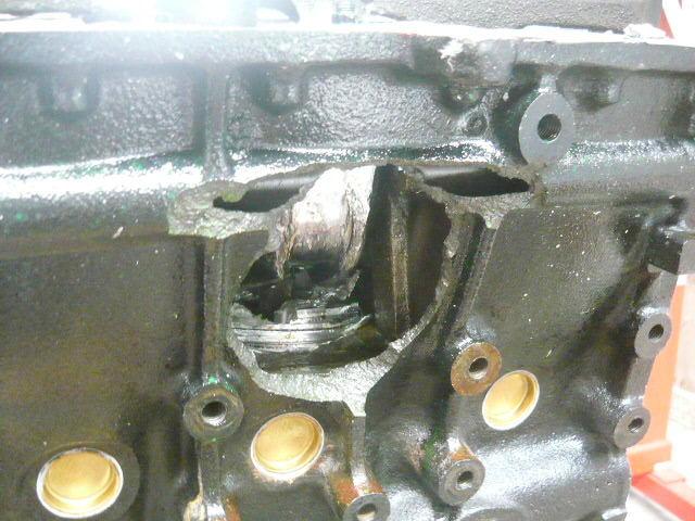 engine destroyed  piston  block wall