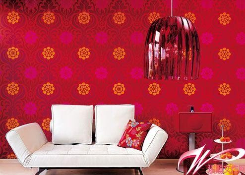 red wallpaper for living room. Red wallpaper + red chandelier, they make the living room very festive.