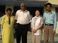 Muneeza, Vibhuti Narain Rai, Lee Koo and Azeem in the library