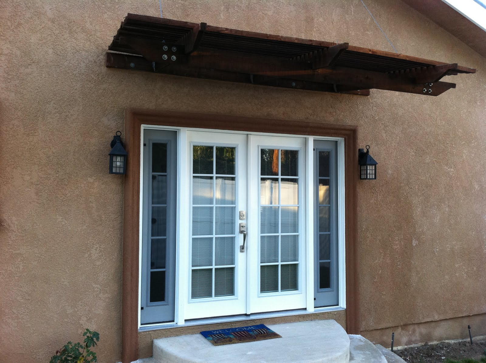 Thb construction back door replaced with double french for Entry door with side windows
