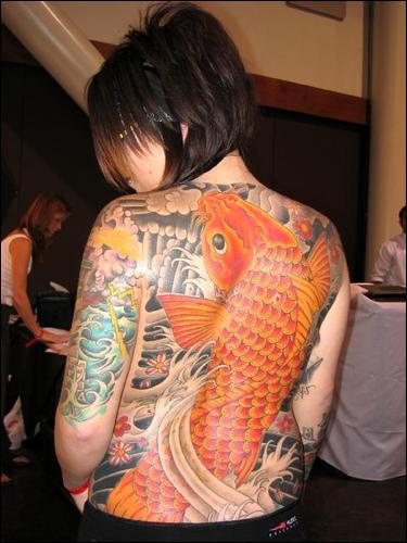 woman tattoo. full back tattoos women
