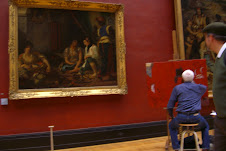 Painter, painting a painting of a painting, at the Louvre