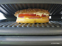 Bagel sandwich on panini grill