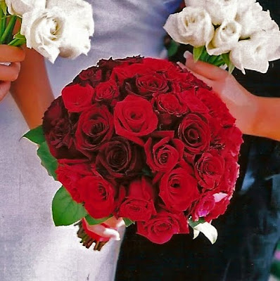 The contrast of the red roses against the damask tablecloth was simply