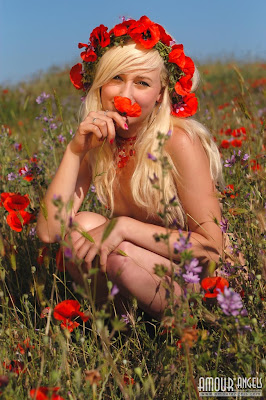 A hot blonde Amour Angel Natasha has fun outdoors stripping naked her beautiful body in red flowers and smiling at camera