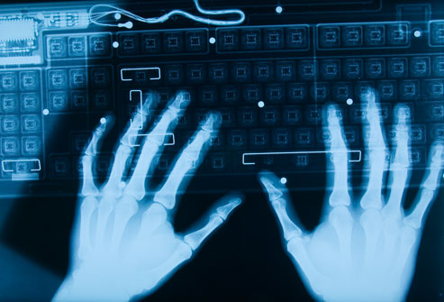 getty_rf_photo_of_x-ray_hands_on_keyboard
