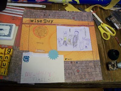 scrapbook page featuring kid art