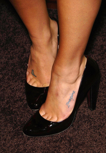 small star tattoo on foot