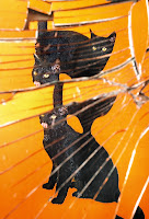 Black cats and a broken mirror.